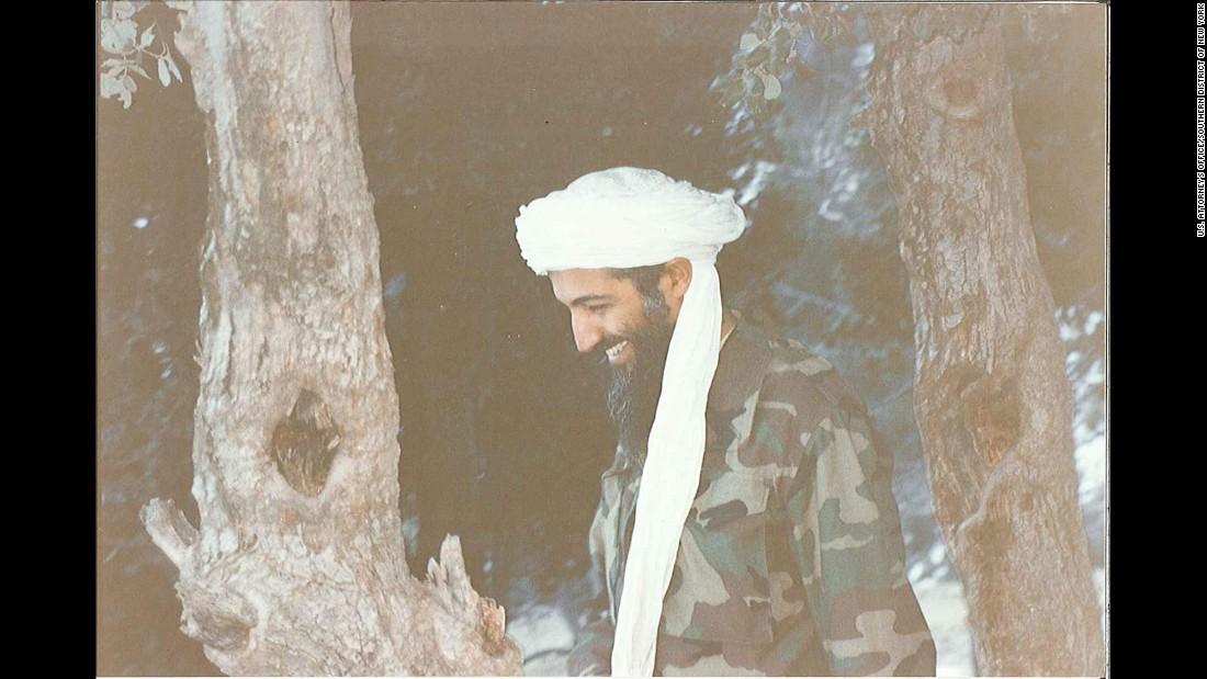Bin Laden laughs during a walk.