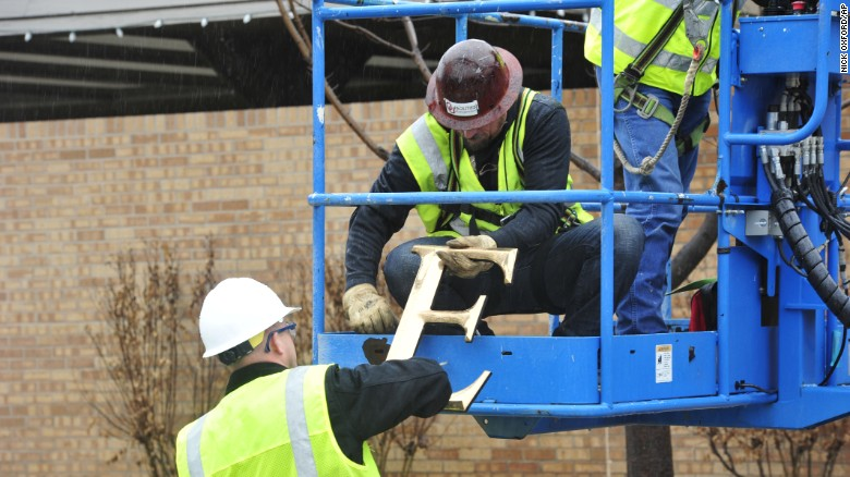 Facility workers removed the letters from the SAE house at the University of Oklahoma on Monday, March 9.