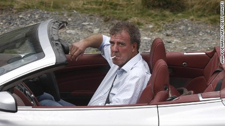 British television BBC presenter of motor show 'Top Gear' Jeremy Clarkson is pictured while he drives an Aston Martin car on Transfagarasan road close to Sibiu city, 300 km northwest from Bucharest, on September 24, 2009. The three presenters, Jeremy Clarkson, Richard Hammond and James May will drive the latest models of Ferrari, Aston Martin and Lamborghini on different roads and cities in Romania as Bucharest, Vidraru dam, Danube Delta and seacoast of Black Sea. AFP PHOTO ANA POENARIU (Photo credit should read ANA POENARIU/AFP/Getty Images)