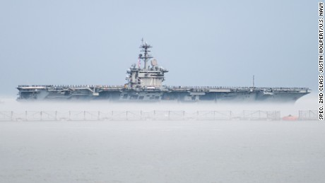The aircraft carrier USS Theodore Roosevelt (CVN 71) departs Naval Station Norfolk for a scheduled deployment. The deployment is part of a regular rotation of forces to support maritime security operations, provide crisis response capability, and increase theater security cooperation and forward naval presence in the 5th and 6th Fleet areas of operation. U.S. Navy photo by Mass Communication Specialist 2nd Class Justin Wolpert (Released) 150310-N-VC599-021