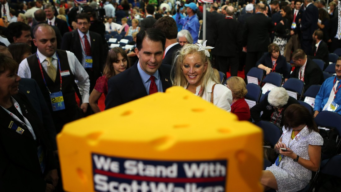 Walker poses with a woman during the Republican National Convention at the Tampa Bay Times Forum on August 28, 2012, in Tampa, Florida.
