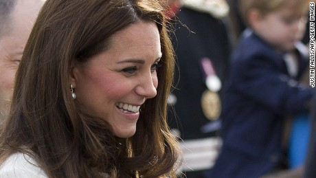 Britain's Catherine, Duchess of Cambridge smiles as she meets members of the cast on the set of British television series Downton Abbey at Ealing Studios in west London on March 12, 2015.