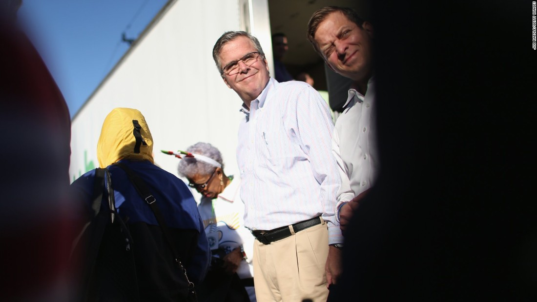 Bush hands out items for Holiday Food Baskets to those in need outside the Little Havana offices of CAMACOL, the Latin American Chamber of Commerce on December 17, 2014, in Miami.