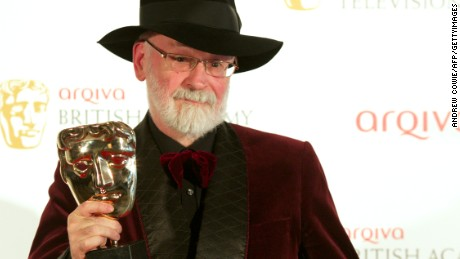 Winner of Best Single Documentary Terry Pratchett poses in front of the winners boards at the British Academy Television Awards at the Royal Festival Hall in London, on May 27, 2012.     AFP PHOTO/ ANDREW COWIE        (Photo credit should read Andrew Cowie/AFP/GettyImages)