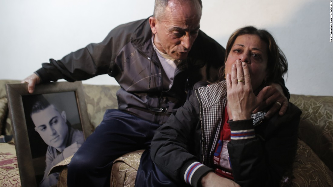 The parents of 19-year-old Mohammed Musallam react at the familys home in the East Jerusalem Jewish settlement of Neve Yaakov on Tuesday, March 10. lt;a href=quot;http://www.cnn.com/2015/03/10/middleeast/isis-video-israeli-killed/quot;gt;ISIS released a video purportedlylt;/agt; showing a young boy executing Musallam, an Israeli citizen of Palestinian descent who ISIS claimed infiltrated the group in Syria to spy for the Jewish state. Musallams family told CNN that he had no ties with the Mossad, Israels spy agency, and had, in fact, been recruited by ISIS.