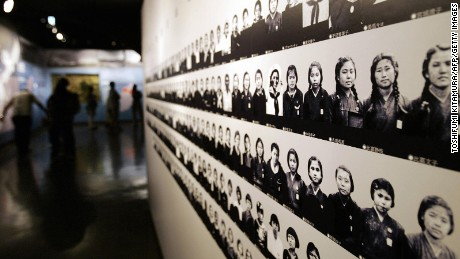 Portraits of members of Himeyuri unit are displayed at the Himeyuri Peace Momorial Museum.