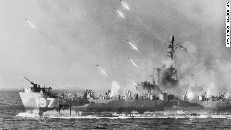 Spring 1945: Rockets from an American warship stream toward Okinawa Island prior to the invasion by U.S. forces.