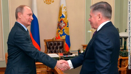 Russian President Vladimir Putin shakes hands with the Supreme Court Chairman Vyacheslav Lebedev, right, in the Novo-Ogaryovo residence outside Moscow, Russia, Friday, March 13, 2015. The Kremlin says Russian President Vladimir Putin, who has been out of public view for more than a week, is to meet on Monday with the president of Kyrgyzstan. (AP Photo/RIA Novosti, Alexei Druzhinin, Presidential Press Service/AP)
