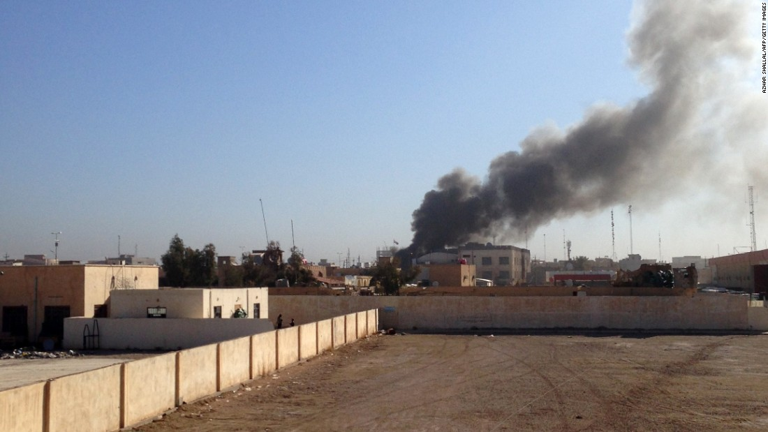 Smoke billows after a mortar shell hit an Anbar governorate building in Ramadi, Iraq, on Wednesday, March 11. ISIS launched a coordinated attack on government-held areas of the western Iraqi city.