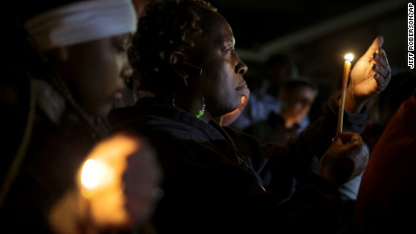 People take part in a candlelight vigil in Ferguson, Missouri, on Thursday, March 12. Two police officers were shot early Thursday morning during a protest in front of the Ferguson Police Department following the resignation of the city's police chief.