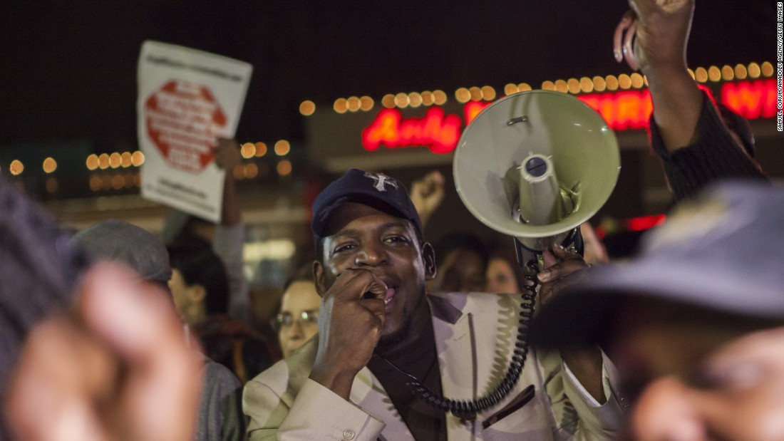 Demonstrators shout slogans during ongoing protests in Ferguson on March 12. Organizers say protests have continued for more than 200 days since Brown's killing.