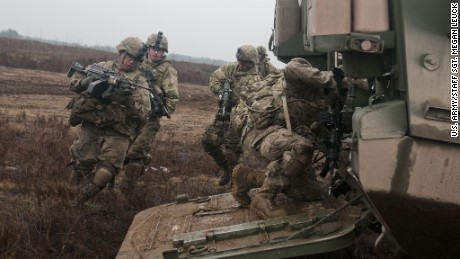 U.S. troopers of 3rd Platoon, Lightning Troop, 3rd Squadron, 2nd Cavalry Regiment, load into a Stryker during a live-fire joint training exercise with Lithuanian soldiers of 3rd Company, Algirdas Mechanized Infantry Battalion, in support of Operation Atlantic Resolve, at Pabrade Training Area, March 2, 2015.
