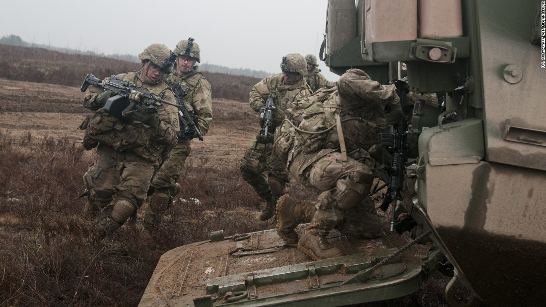 U.S. troopers of 3rd Platoon, Lightning Troop, 3rd Squadron, 2nd Cavalry Regiment, load into a Stryker during a live-fire joint training exercise with Lithuanian soldiers of 3rd Company, Algirdas Mechanized Infantry Battalion, in support of Operation Atlantic Resolve, on March 2, 2015.