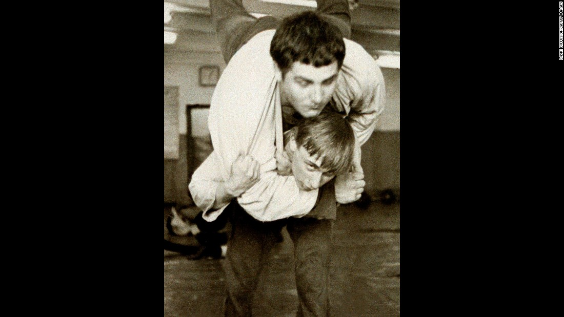 Putin, bottom, wrestles with a classmate in St. Petersburg, Russia, in 1971.