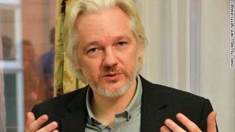 FILES - WikiLeaks founder Julian Assange gestures during a press conference inside the Ecuadorian Embassy in London on August 18, 2014 where Assange has been holed up for two years. Swedish prosecutors on March 13, 2015 offered to question WikiLeaks founder Julian Assange in London over rape allegations that have driven him to take refuge in the Ecuadorean embassy in the British capital.