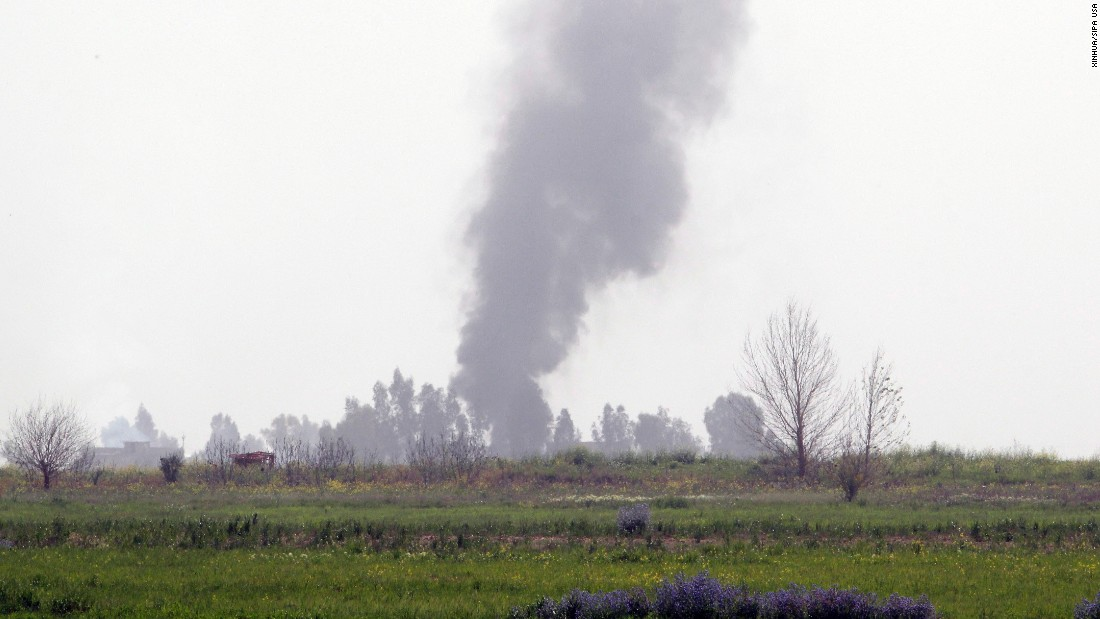 Smoke rises from the front line of a clash south of Kirkuk, Iraq, on Saturday, March 14.