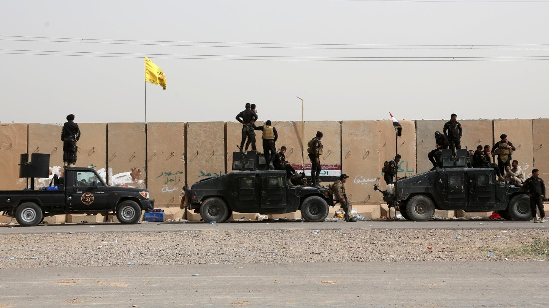 Iraqi security forces and allied Shiite militiamen gather in Tikrit on Friday, March 13. Ousting ISIS from Tikrit is important for the United States-led coalition trying to thwart the extremist group's quest to grow its caliphate. ISIS wants to create an Islamic state across Sunni areas of Iraq and Syria.