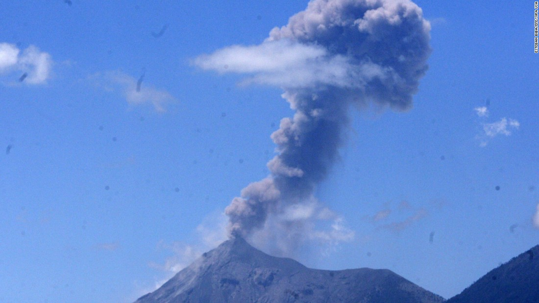 The Fuego volcano spews a cloud of ash west of Guatemala City, Guatemala, on Thursday, March 12.