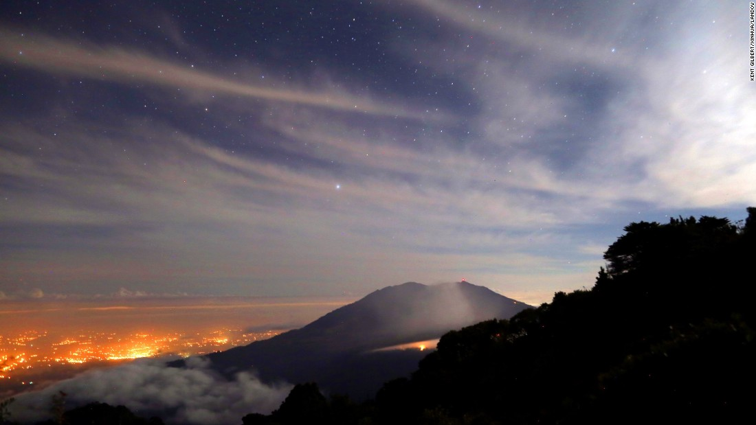 Smoke rises from Turrialba Volcano in Turrialba, Costa Rica, on Friday, March 13. Eruptions of ash and stones prompted authorities to evacuate nearby residential areas.