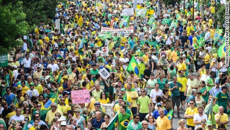 Demonstrators rally to protest against the government of president Dilma Rousseff in Porto Alegre, Brazil on 15 March, 2015. Tens of thousands of Brazilians turned out for demonstrations Sundays to oppose leftist president Dilma Rousseff, a target of rising discontent amid a faltering economy and a massive corruption scandal at state oil giant Petrobras.