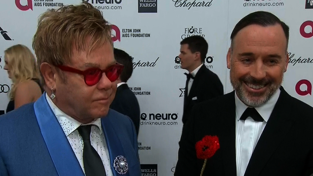"Elton John <a href=""http://www.cnn.com/2014/12/21/showbiz/elton-john-wedding/index.html"">married longtime partner David Furnish</a> in December 2014. The duo have two sons conceived via in-vitro fertilization and carried by surrogate mothers. By March 2015, the famously outspoken singer was embroiled in a war of words <a href=""http://www.cnn.com/2015/03/15/living/feat-elton-john-dolce-gabbana/index.html"">with fashion designers Dolce & Gabbana</a>, who said they opposed ""synthetic"" children from ""rented"" wombs."