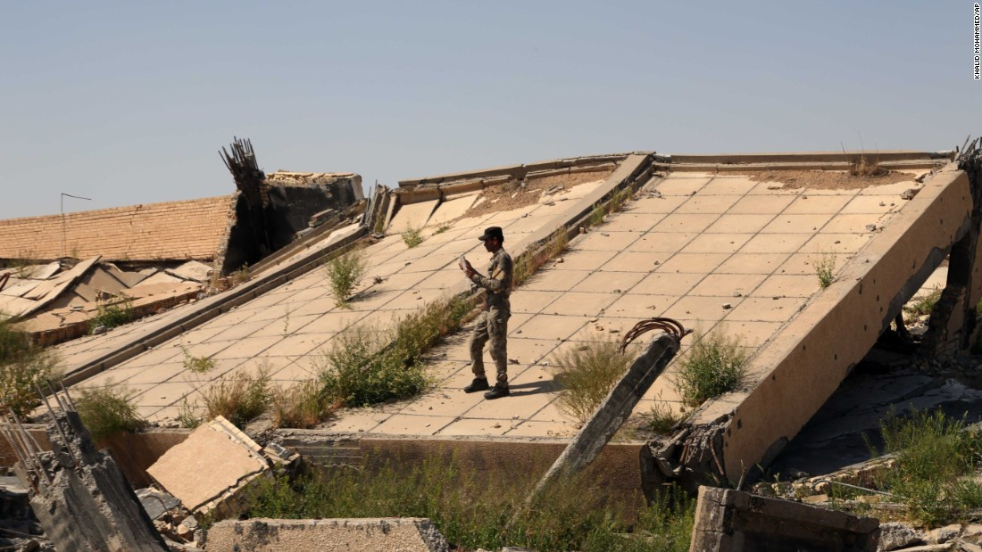 "An Iraqi soldier takes photos of the <a href=""http://www.cnn.com/2015/03/16/middleeast/iraq-isis-babylon-safe/index.html"" target=""_blank"">demolished tomb of former Iraqi President Saddam Hussein</a> on Sunday, March 15. The tomb in Tikrit, Iraq, was destroyed as Iraqi forces battled the ISIS militant group for control of the city."