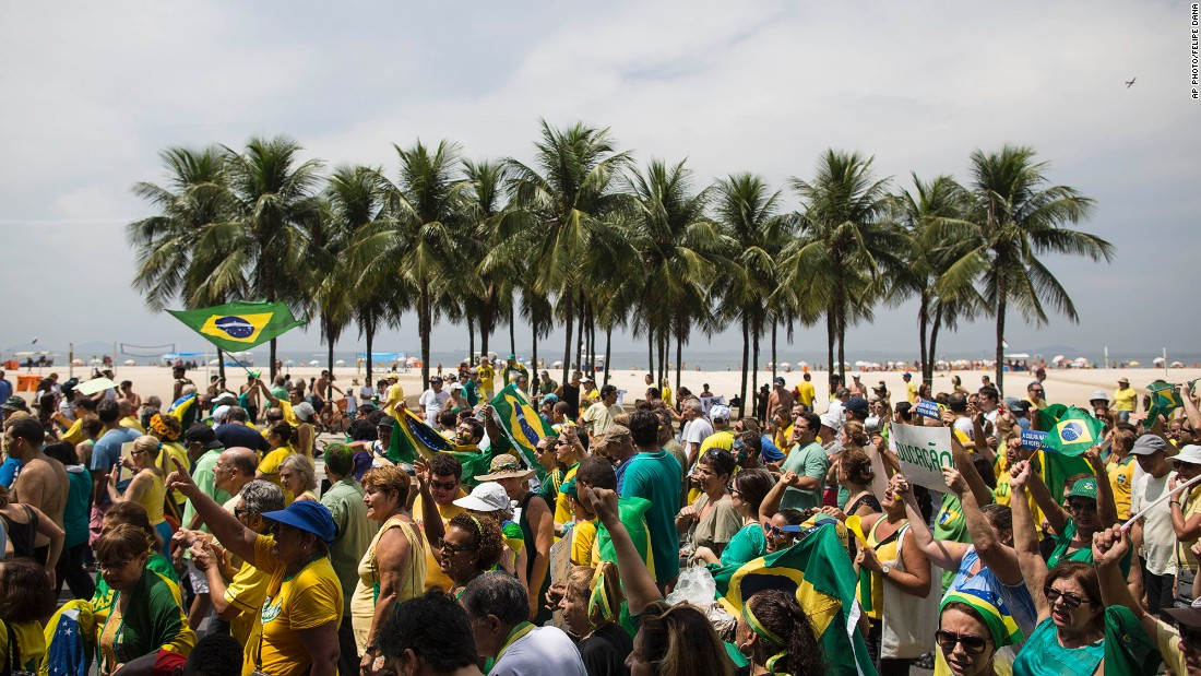 Brazilians march along Copacabana beach.