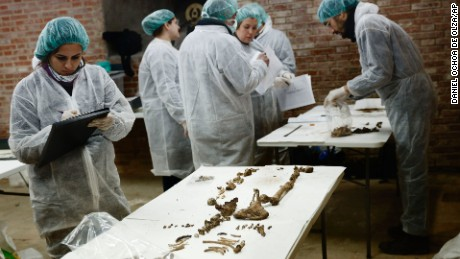 A team of archaeologists and anthropologists take notes after starting the excavation work after identifying three unrecorded and unidentified graves in the chapel's crypt of the closed order Convent of the Barefoot Trinitarians in Madrid's historic Barrio de las Letras, or Literary Quarter, Spain, Saturday, Jan. 24, 2015. Experts searching for the remains of Miguel de Cervantes hope they may be entering the final phase of their nine-month quest to solve the mystery of where the great Spanish writer was laid to rest. The 'Don Quixote' author was buried in 1616 at the Convent but the exact whereabouts of his grave in the tiny convent chapel are unknown. The bones found will be exhumed and analyze, after that, the experts will try to identify the bones using DNA profiling. (AP Photo/Daniel Ochoa de Olza/AP)