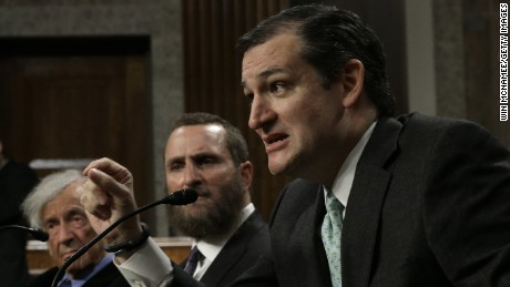 Nobel Peace Laureate Elie Wiesel (left) listens as Sen. Ted Cruz (right) (R-TX) speaks during a roundtable discussion on Capitol Hill March 2, 2015 in Washington, D.C. Wiesel, Cruz and Rabbi Scmuley Boteach (center) participated in a discussion entitled 'The Meaning of Never Again: Guarding Against a Nuclear Iran.'