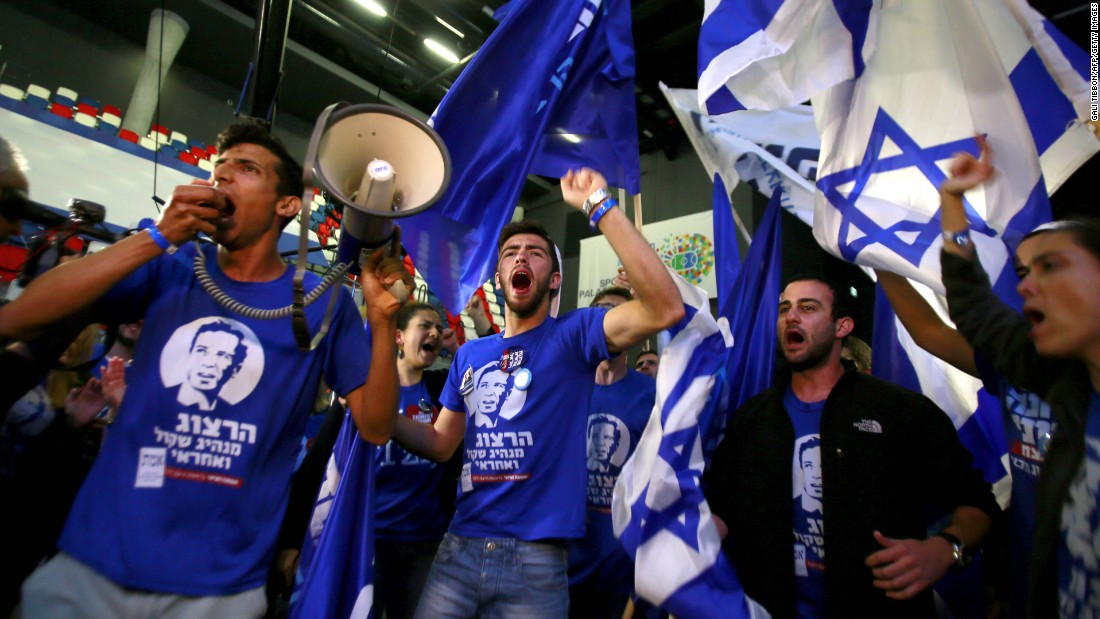 Supporters of the Zionist Union alliance take part in early celebrations as they wait for election results March 17 in Tel Aviv.