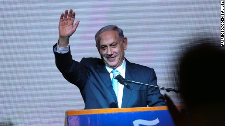 Israeli Prime Minister Benjamin Netanyahu greets supporters at the party's election headquarters In Tel Aviv. Wednesday, March 18, 2015.