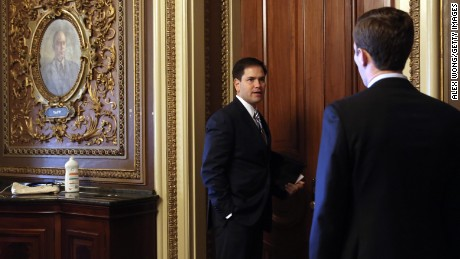 U.S. Sen. Marco Rubio (R-FL) speaks to an aide as he arrives for the weekly Senate Republican Policy Committee luncheon September 24, 2013 on Capitol Hill in Washington, D.C. Senate Republicans held the luncheon to discuss Senate Republican agendas.