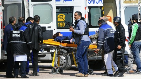 A person is evacuated by rescue workers on a stretcher outside the Bardo museum in Tunis, Wednesday, March 18, 2015 in Tunis, Tunisia.