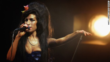 GLASTONBURY, UNITED KINGDOM - JUNE 28:  Amy Winehouse performs on the Pyramid Stage at the Glastonbury Festival at Worthy Farm, Pilton on June 28 2008 in Glastonbury, Somerset, England. Nearly 175,000 people were expected to be on site for the three-day music festival which started yesterday and features headline acts Kings of Leon, rapper Jay-Z and Britpop veterans The Verve.  (Photo by Matt Cardy/Getty Images)
