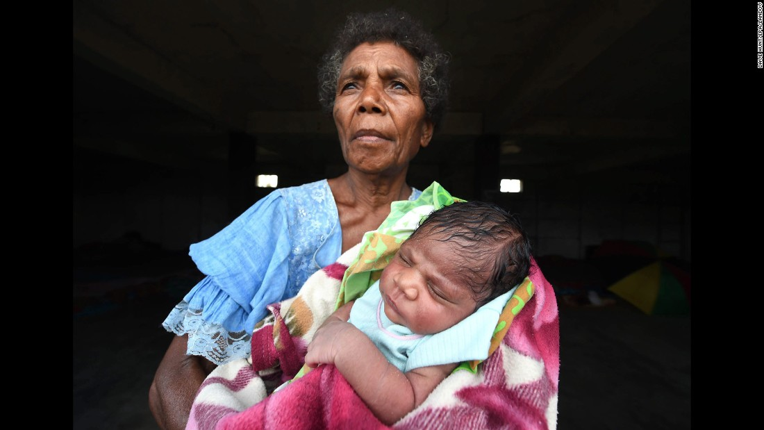 Mercy Watskal holds her week-old granddaughter, Angelina, at the Enima Evacuation Center on Tanna Island on March 19.