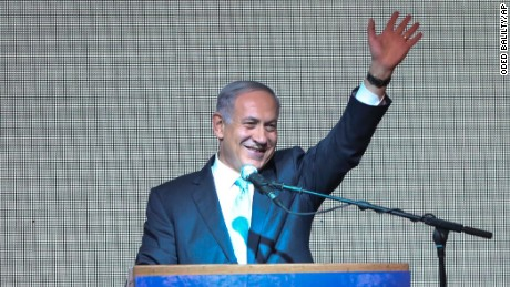 Israeli Prime Minister Benjamin Netanyahu greets supporters at the party's election headquarters In Tel Aviv.Tuesday, March 17, 2015. Exit polls from Israel's national elections showed Prime Minister Benjamin Netanyahu's Likud party nearly deadlocked with Isaac Herzog's center-left Zionist Union. (AP Photo/Oded Balilty)