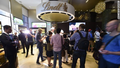 Members of the media visit the Lindt Cafe at Martin Place in Sydney ahead of the re-opening on March 20, 2015. The Lindt cafe opened three months after a siege in which a gunman held customers and staff hostage for 17 hours ending with two hostages dead and a permanent memorial to victims Katrina Dawson and Tori Johnson on display in the cafe. AFP PHOTO/Peter PARKSPETER PARKS/AFP/Getty Images