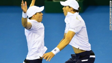 Caption:GLASGOW, SCOTLAND - MARCH 7 : Bob Bryan (L), and Mike Bryan of the United States celebrate their win in five sets against Dominic Inglot and Jamie Murray of the Aegon GB Davis Cup Team during the doubles match on Day 2 of the Davis Cup match between GB and USA at the Emirates Arena on March 7, 2015 in Glasgow Scotland. (Photo by Mark Runnacles/Getty Images)
