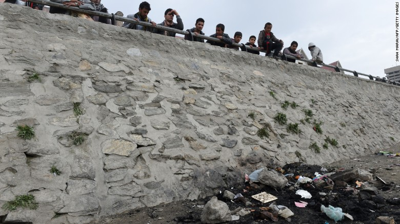 Afghan residents look at the site where an Afghan woman was beaten to death and her body set alight by a mob, in Kabul on March 20, 2015. An Afghan woman was beaten to death and her body was set on fire by a mob in Kabul on March 19 for allegedly burning a copy of the Koran, police officials said. AFP PHOTO / SHAH Marai (Photo credit should read SHAH MARAI/AFP/Getty Images)