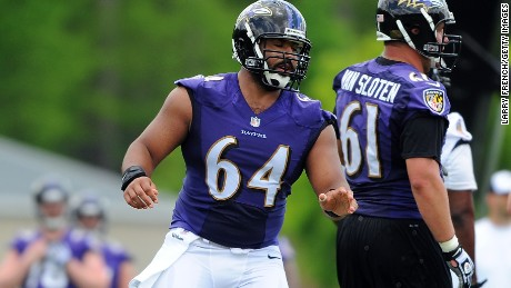 Caption:BALTIMORE, MD - MAY 17: Center John Urschel #64 of the Baltimore Ravens participates in the Baltimore Ravens Rookie Minicamp on May 17, 2014 in Baltimore, Maryland. (Photo by Larry French/Getty Images)