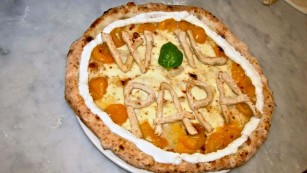 "A pizzeria in Naples baked a special ""Papa"" pizza for the Pope."