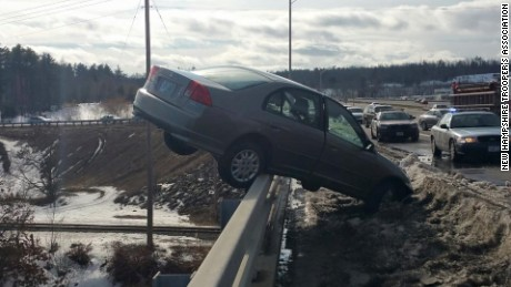 "Colin Malone, 17, lost control of his car on Saturday, March 21, 2015, in Nashua, New Hampshire, struck a snow mound and was ""pitched in the air before coming to rest on the railing of the Sagamore Bridge above the Merrimack River,"" according to a statement on the New Hampshire Trooper's Association's Facebook page."