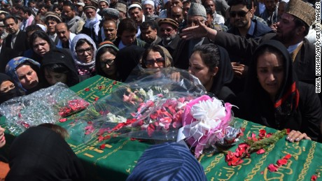 Independent Afghan civil society activist women carry the coffin of Farkhunda, 27, who was lynched by an angry mob in central Kabul on March 22, 2015. Hundreds of people on March 22, attended the burial of an Afghan woman who was beaten to death and set on fire by a mob for allegedly burning a copy of the Koran. The body of Farkhunda, 27, who was lynched on March 19 by an angry mob in central Kabul, was carried to the graveyard by women amid crowds of men, an AFP reporter said, a rare act of protest in a male-dominated society. AFP PHOTO / Wakil Kohsar (Photo credit should read WAKIL KOHSAR/AFP/Getty Images)