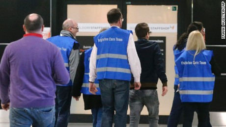 Airport staff in Duesseldorf escort people to a waiting area on March 24.