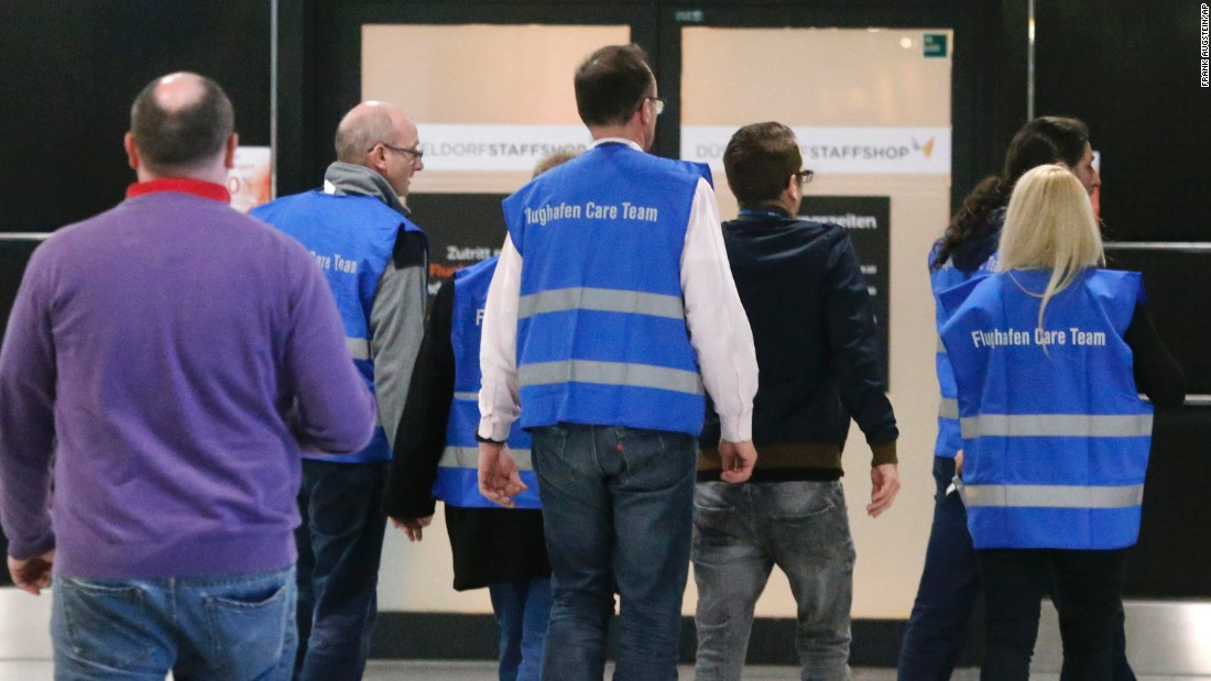 Airport staff in Dusseldorf escort people to a waiting area on March 24.