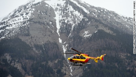 A helicopter carries security personnel on March 24 in Seyne, France, near the crash site.