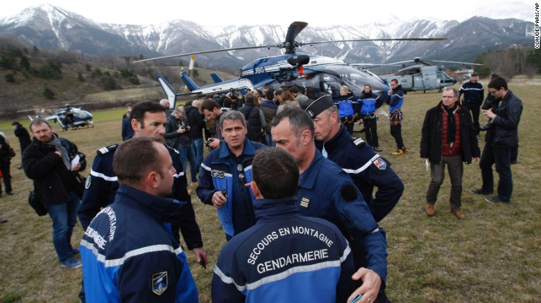 Rescue workers and members of the French Gendarmerie gather in Seyne, France, on Tuesday, March 24, as search-and-rescue teams struggle to reach the remote crash site of Germanwings Flight 9525. The Airbus A320 was carrying at least 150 people when it crashed in the French Alps. The plane was en route from Barcelona, Spain, to Dusseldorf, Germany.