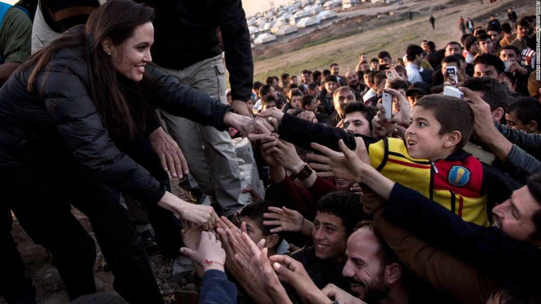 Angelina Jolie meets members of the Yazidi minority at a refugee camp in Khanke, Iraq, in January. She celebrated her 40th birthday on Thursday. Despite recent recognition for her humanitarian works and action movies, Jolie has been in the spotlight since she was a child. Here's a look at her life.