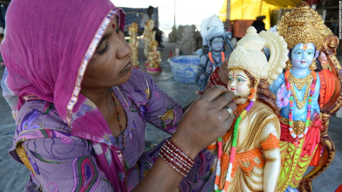 MARCH 24 - HYDERABAD, INDIA: An artist puts the final touches to statues of Hindu Gods Rama, his brother Lakshman, wife Sita and devotee Hanuman at a workshop ahead of the Rama Navami festival. Celebrations will be held on March 28, commemorating both the birth of Rama and his wedding to Sita.
