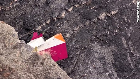 A screen grab taken from an AFP TV video on March 24, 2015 shows part of the vertical stabilizer of the Germanwings Airbus A320 at the crash site in the French Alps above the southeastern town of Seyne. The plane, which had taken off from Barcelona in Spain and was headed for Dusseldorf in Germany, crashed earlier in the day with 150 people onboard. AFP PHOTO /DENIS BOIS /GRIPMEDIA / AFP TVDENIS BOIS/AFP/Getty Images